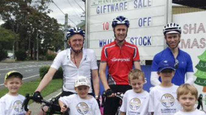 GOOD CAUSE: Bob Montgomery and his team at one of the stops on their way to Port Douglas.