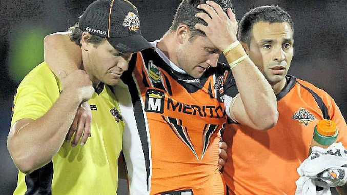 FLASHBACK: Tim Moltzen (centre) leaves the field injured during the game against the Brisbane Broncos earlier this year.