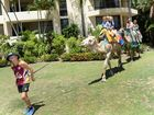 Trent Richardson leading a pair of camels around the grounds at the Mercure Capricorn Resort Kids Christmas Party. Photo: Chris Ison / The Morning Bulletin
