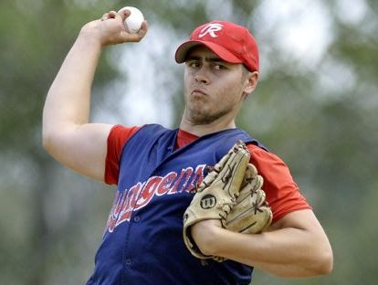 PITCHING IN: Sam McNeice pitches for Toowoomba Rangers against Ipswich.