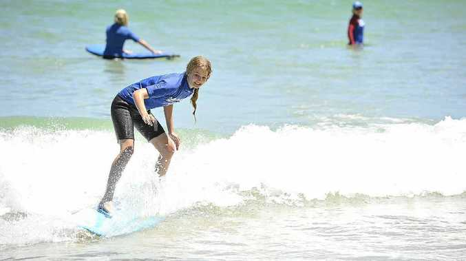 GO GIRL: Luci Andrew participating at the Girls Go Surfing day at Clarks Beach, Byron Bay.