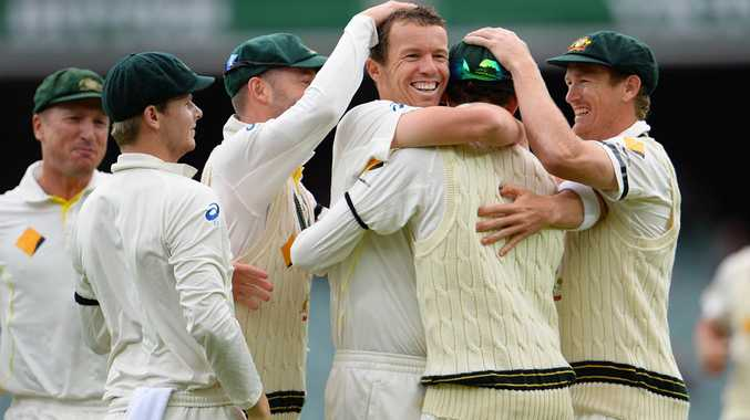 Australian fast bowler Peter Siddle (3/R) is congratulated by teammates after dismissing England batsman Stuart Broad on the final day of the second Ashes cricket Test match in Adelaide, on December 9, 2013.