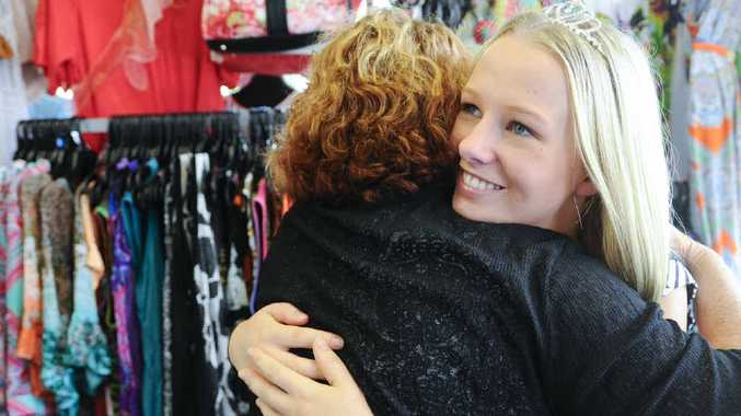 Go Girlz owner Kerry Flanagan gives Jacaranda Queen Cerene Lowe a hug of appreciation after Cerene stopped a woman stealing goods from the shop. Photo: JoJo Newby