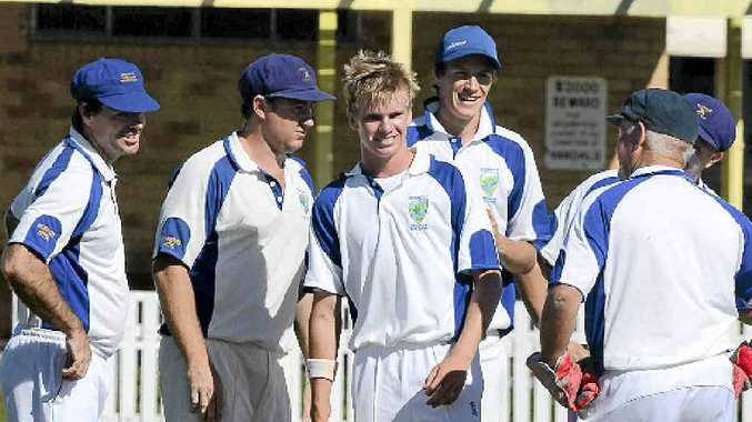 GOLDEN TOUCH: Harwood bowler Harry Nicholson is surrounded by teammates after getting a wicket against Easts on Saturday. Photo: Debrah Novak
