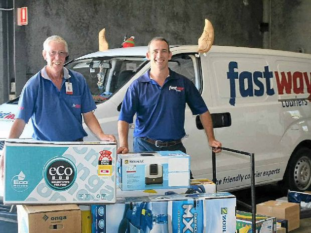 CHRISTMAS CHEER: Fastway Goonellabah courier Dave Fraser and Fastway Northern Rivers franchisee Rod Lawson with their reindeer-themed van, getting ready for the Christmas rush.