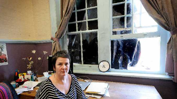 SHATTERED: Anita Bellman, executive director of the Northern Rivers Conservatorium of Music where 18 windows were broken on Saturday night.