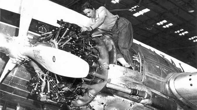 MEN'S WORK: Connie Jordan, who worked for a time at the North Coast Girls College, now Ballina Manor, was Qantas' first female licensed ground engineer. She is pictured working on an engine of a Qantas DC-3. Mary Thurston has supplied the image to researcher Colin Lock.