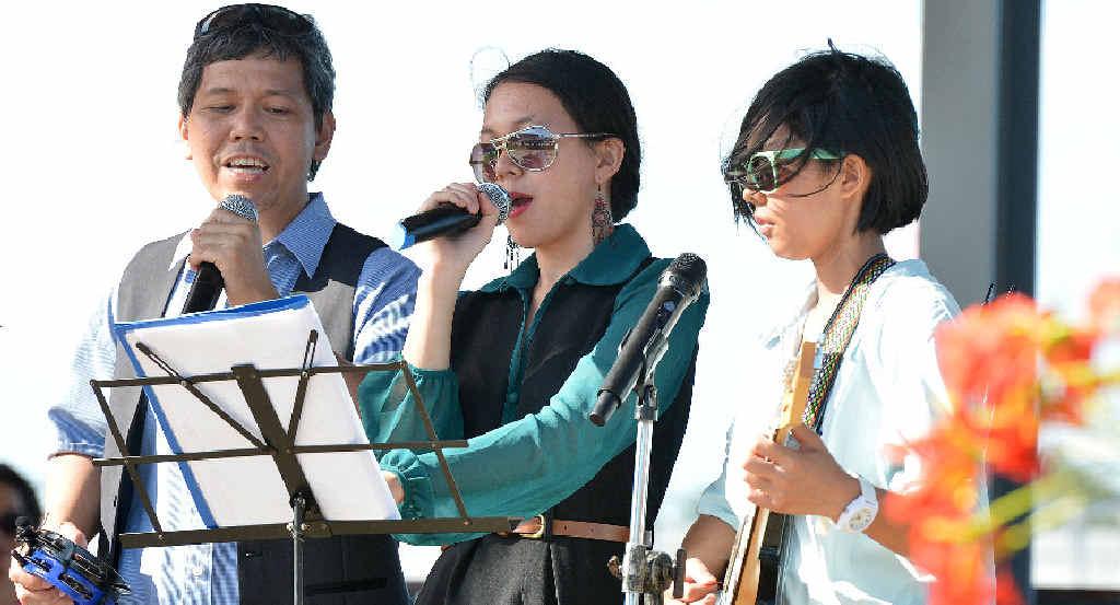 Zion Site band members Victor Valduz, Markeen Valduz and Iris Valduz sing their original gospel and inspirational songs at the community fundraiser for victims of Typhoon Haiyan
