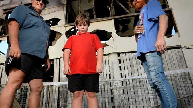 BATTLING: Aussie Battler Removals owner Trevor Wooderson with Jackson and Tully Roberts at their burnt out home at Painswick Street.