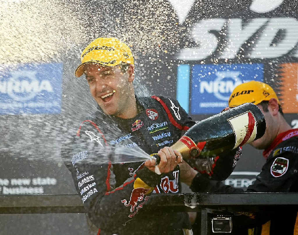 WINNER: Jamie Whincup celebrates winning the V8s championship.