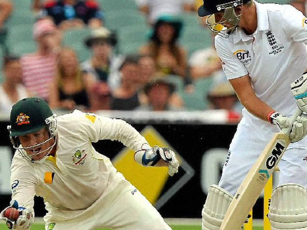 KEY WICKET: Brad Haddin dives to catch Joe Root for 87 at Adelaide Oval yesterday to complete 200 catches in Test cricket.
