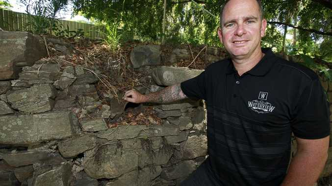 WATERVIEW DISTILLERY: Rick Prosser on the site of the old North Bundaberg distillery, with an old brick and stone wall dating from the mid to late Nineteenth Century. Photo: Simon Young / NewsMail