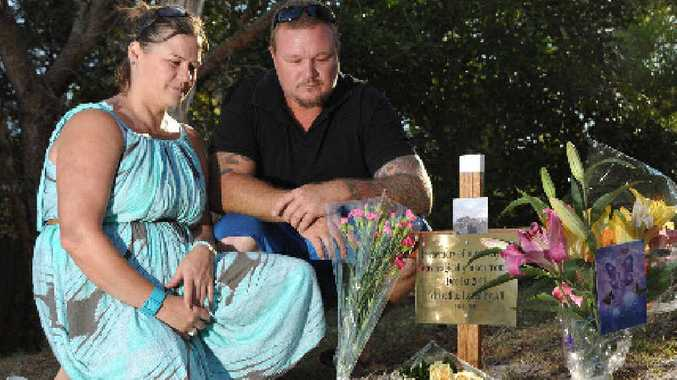 IN TRIBUTE: Best friend Anita Sabidussi and Lyn Raines' partner Adam Dahl pay their respects at the location of the accident where the 52-year-old woman died on December 1.