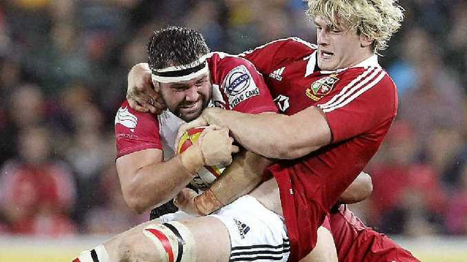 STILL OUT: James Hanson of the Reds (left) is tackled by British and Irish Lions forward Richie Gray in Hanson's last game before picking up a neck injury.