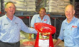 ON THE ROAD: PBA Feeds director Peter Brodie, sales representative Will Bazley and logistics manager Philip Best with some of the 10 tonnes of Droughtbuster lick which was sent last week to drought-ravaged cattle producers in the Charleville district.