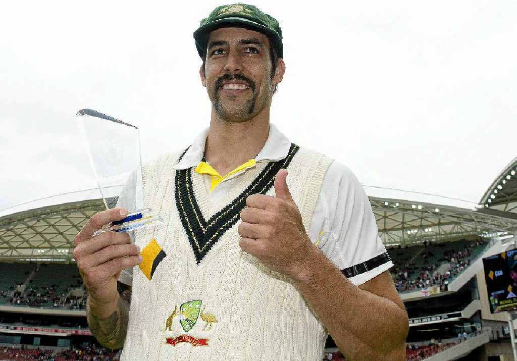 TOP PLAYER: Australian speedster Mitchell Johnson celebrates his man-of-the-match award yesterday after the second Test win over England on day five at Adelaide Oval.