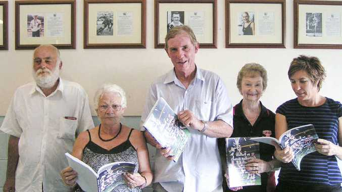 FOR POSTERITY: Grafton Basketball life members Bruce Leonard and Jo Morgan, author and historian Kerry Wilsmore, life member Roma Brotherson and current president Sandra Dahl peruse The History of Grafton Basketball (1953-2013). PHOTO: CONTRIBUTED