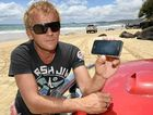 A new Telstra 4G service will give Rainbow Beach holiday makers, like Gerard Warhurst, better coverage at Christmas.