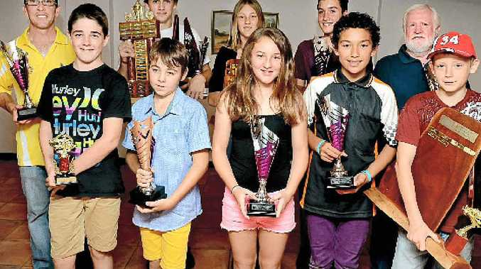 LISMORE Kart Club champions for 2013 at their presentation are, front row, from left, Encouragement Award, Jake McRae; Cadets champion, Zayd Tones; Rookies champion, Eryn Osborne; Junior National Light champion, Kaleb Veal; overall Cadets / Rookies champion, Nathan Herne; back row, from left, Tag Restricted Light champion, Michael Scutt; Sportsman Light and overall senior champion, Jacob Jolley; overall junior champion, Natasha Herne; Junior National Heavy champion, Matthew Neil; and Tag Restricted Heavy champion, Red Garrard. Absent: Senior Pro champion Simone Attard.BELOW: Matthew Neil on his way to winning the Junior National Heavy championship at the Lismore Kart Club track.