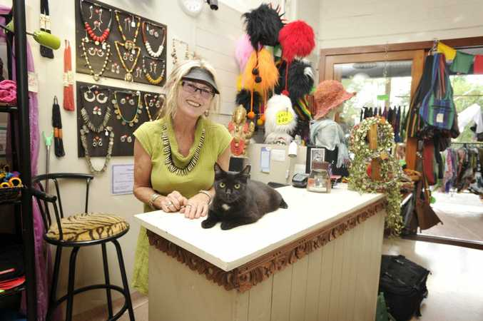 Lesley Clere of OzKat clothing shop in Nimbin, with Shoppy now called Hoppy after loosing one leg. Photo Mireille Merlet-Shaw / The Northern Star