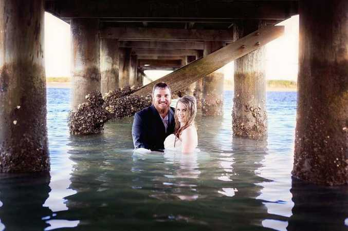 Mel and Jeremy Long took a dive on their trash the dress photo shoot.