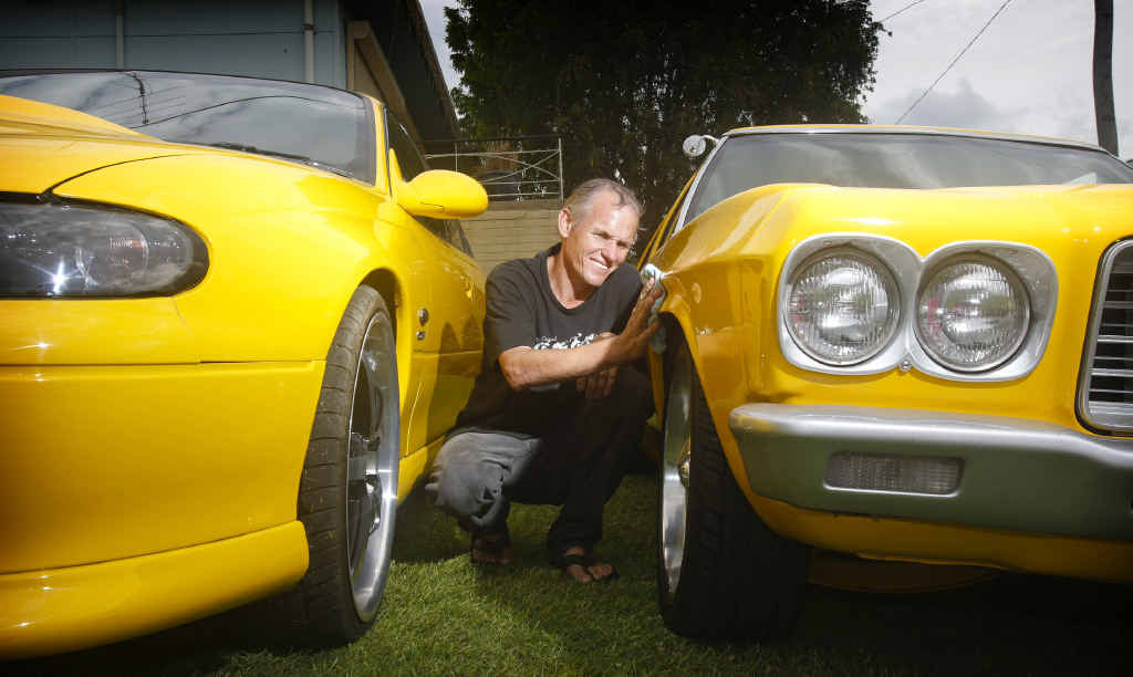 SHEEN DULLED: Holden fancier Jamie Ferguson of South Grafton gives his VT SS Commodore and '74 HQ Holden a polish despite the disappointing news of Holden's decision to end Australian manufacturing.