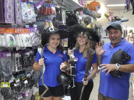 Party Hut workers Alice Mason, Millia McDonald and Paul Mason prepare for Friday the 13th.