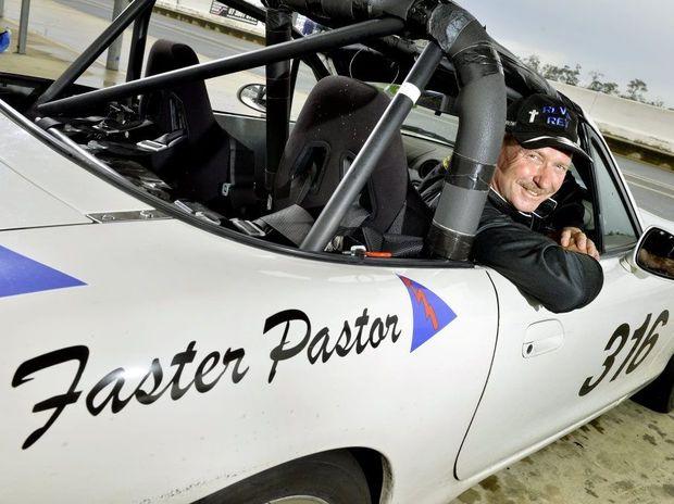 ADRENALINE RUSH: Grace Christian Church Pastor David Smith enjoys the world of race car driving.