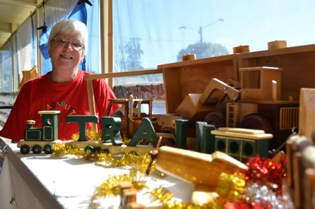 Marcia Blackford, from the Timbertowns Woodworking Group, with the prizes for their raffle. Photo: Louise Cheer / South Burnett Times