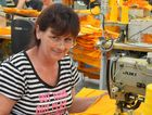 Seamstress Leigh Hanley at work at Gympie clothing manufacturer Drummond and Kindred.