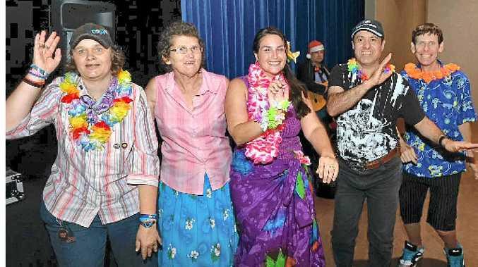 JOLLY GOOD: Robyn Sinclair, Susan Hunt, DJ Ella, Raefel Wert and Stephen Underwood enjoy Endeavour Foundation's Norma Greig Fun Day at Kawana.