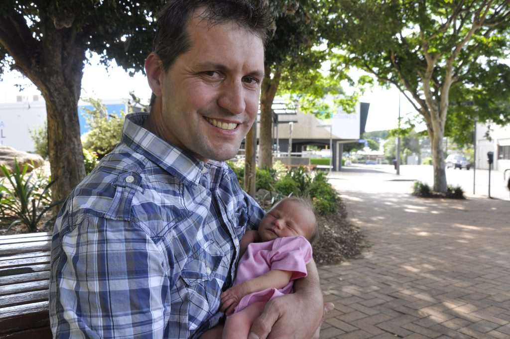 Matthew Bruggemann holds his newborn daughter Lillian. He is angry about service he received from Toowoomba Regional Council customer service centre.