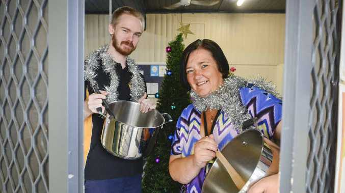 FOOD'S UP: Volunteers Paul Pritchard and Sharon Magree get ready to serve Christmas lunch at the New School of Arts on Christmas Day.PHOTO: ADAM HOURIGAN