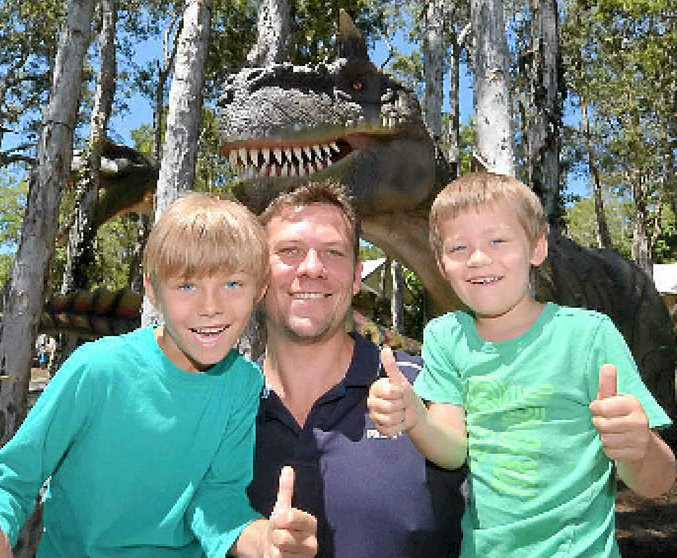IMPRESSED: Buderim's Andrew, Ashton and Oliver Johnson give Palmersaurus the thumbs-up.