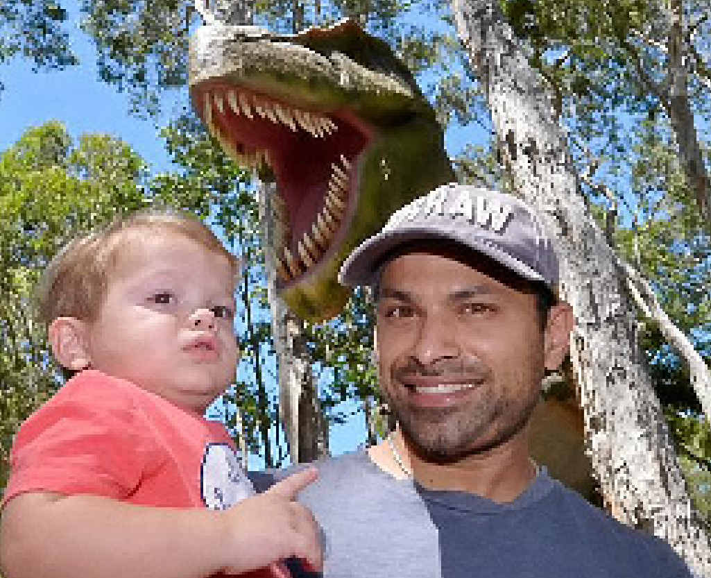 EYE-OPENER: Ranjit Paul gives one-year-old Lincoln an introduction to the world of dinosaurs.