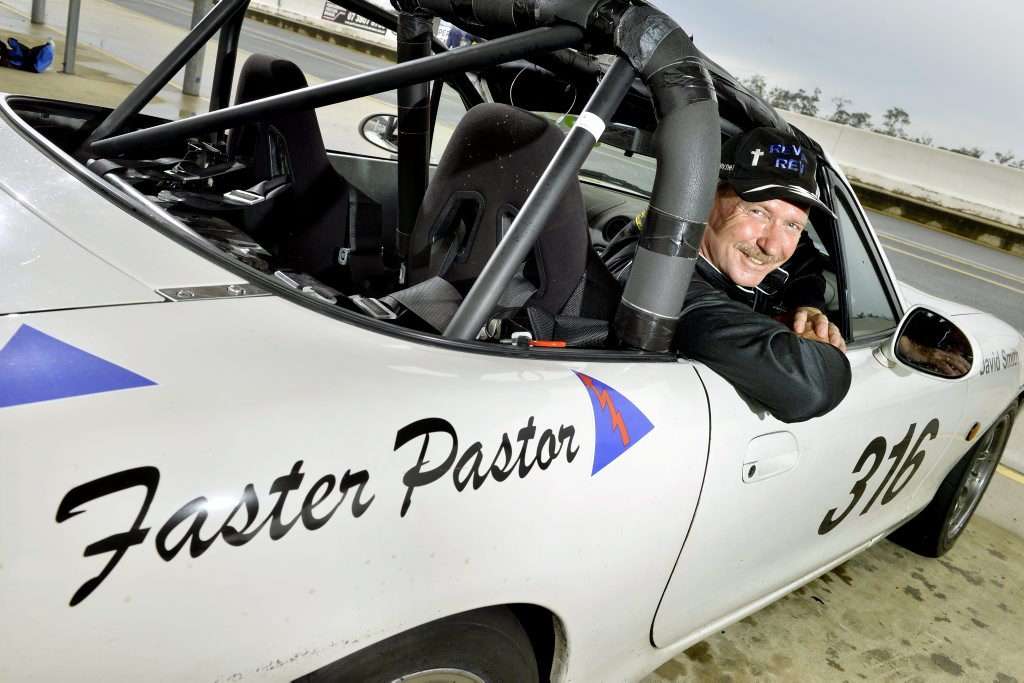 ADRENALINE RUSH: Grace Christian Church Pastor David Smith enjoys the world of race car driving.