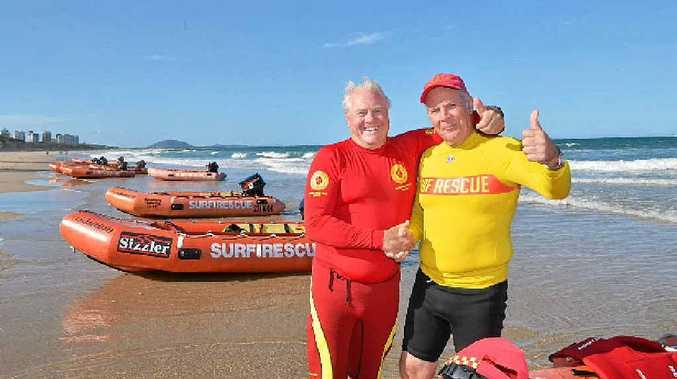 FANTASTIC FEELING: Chris Vorbach and Lex Heilbrohn celebrate finishing the 1100km fundraising voyage from Bondi.