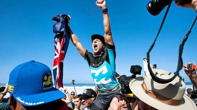 HOW SWEET IT IS! Mick Fanning celebrates after winning the world title yesterday.