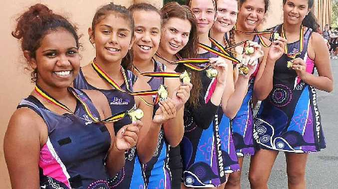 WINNERS ARE GRINNERS: Celebration time for the Lismore Bundjalarms side after their efforts at the recent Queensland Murri Indoor Netball Carnival.