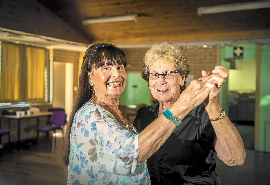Elaine Cox and Valda Garson practice for the Benaraby Progress Association's benefit dance on Saturday.