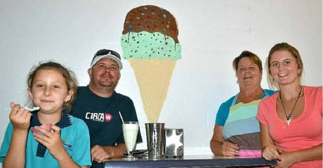 SWEET TREATS: Ella Griffiths and dad Jamie check out the new ice cream shop Muzza's Milk Bar in Oak Street, Evans Head, with owners Petria and Lizzy Powell.