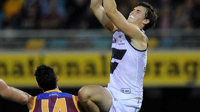 Phil Davis of Greater Western Sydney spoils the mark during the Round 21 AFL match between the Brisbane Lions and the Greater Western Sydney Giants at the Gabba in Brisbane, Saturday, Aug. 17, 2013. (AAP Image/Matt Roberts) NO ARCHIVING, EDITORIAL USE ONLY