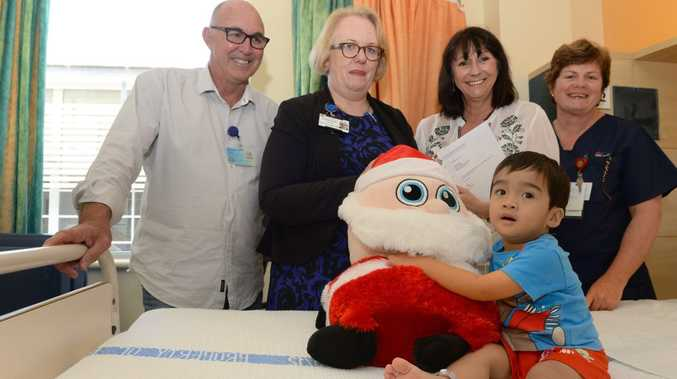 Tweed Hospital childrens ward patient Sean Labudiong with OnTrack's Trevor Shearn, Hospital Executive Director Bernadette Loughnane, On Track's Leone Crayden and RN Kathy Bush.