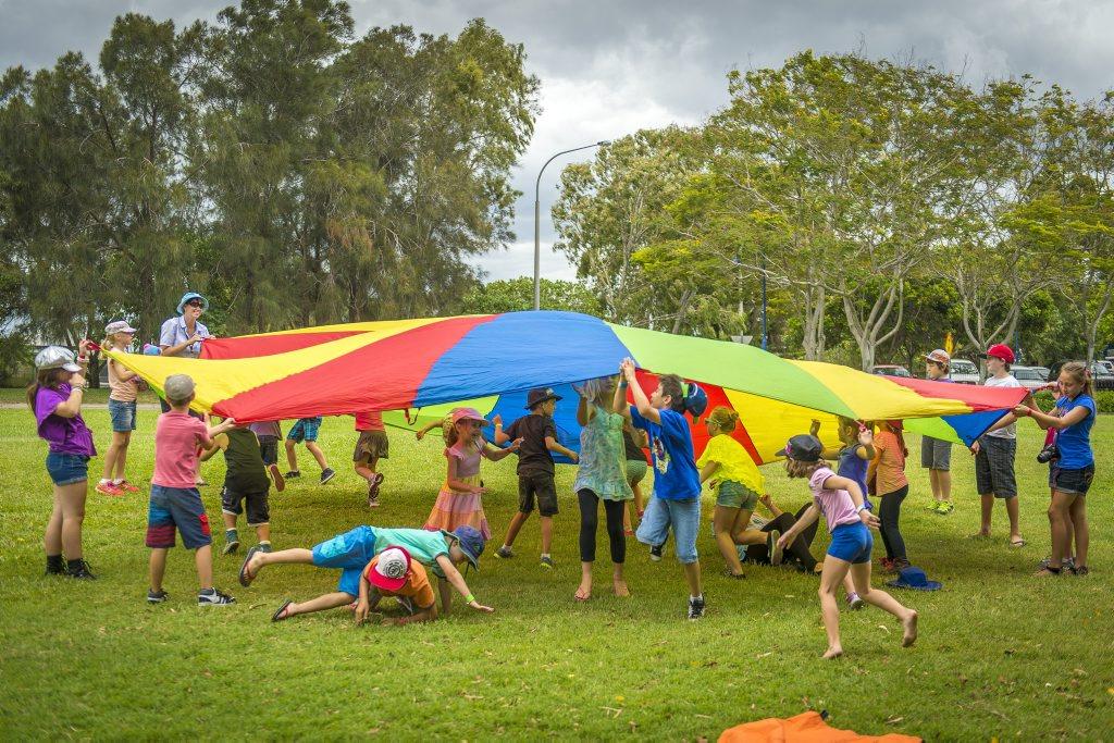 Kids enjoying the parachute during the PCYC Teddy Bear Picnic held at the Gladstone Marina, Gladstone.