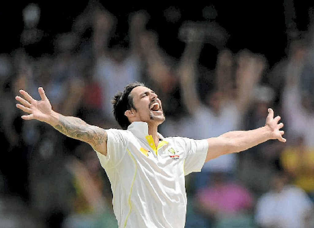 Mitchell Johnson celebrates taking the final wicket of James Anderson in Perth yesterday.