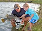 Willem and Callum Reichard after catching Callum's biggest barra.