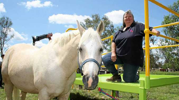 DREAM RAMP: LVRDA president Jacqueline McAnally tries out the new ramp with Macca after it was donated by Gay Constructions on Monday.