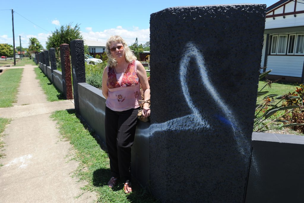 COMMUNITY VANDALISM: Branyan Street resident Anette Boles is upset that vandals have sprayed her fence with paint. Photo: Mike Knott / NewsMail