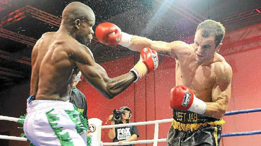Jarrod Fletcher, pictured (right) fighting Philip Kotey, will have his first world title bout in February.
