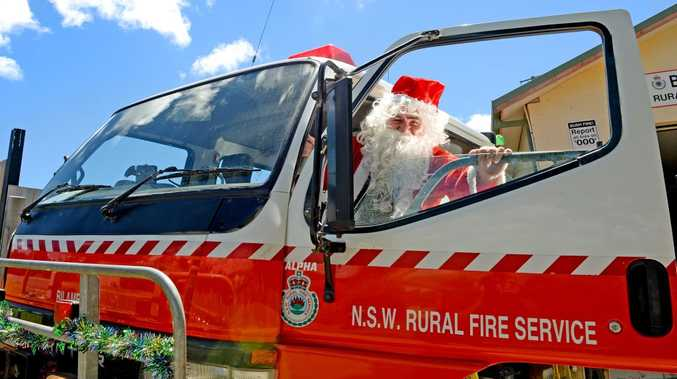 Fire Fighter Jim Thomas will be throwing lollies out to all the kids in the streets of Bilambil on Christmas eve.
